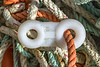 Parlour pot plastic spinner attached to a very long rope washed up at Soldier Bay on Guernsey's east coast