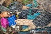 Litter collected from Petit Port beach stored behind the fence at the top of the shore on the 8th February 2016