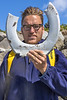 Pierre Ehmann with a partial toilet seat he removed from boulders forming the revetment of Pecqueries Bay