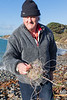 Volunteer beach cleaner Paul Le Gallez with some fishing line he has collected from the sea shore