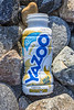Yazoo banana flavoured milk drink bottle on the Belle Greve Bay shore on Guernsey's east coast on 12th February 2021