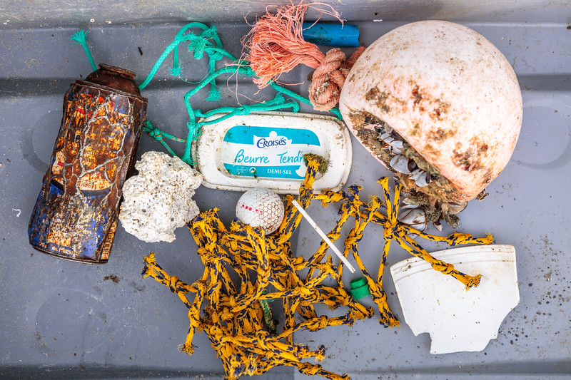 Marine litter washed up in a small bay at Pleinmont on Guernsey's south west coast on 9th October 2020