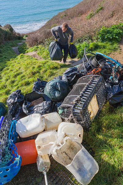Hauling bags of litter from the Petit Port sea shore to the top of the cliff on the 19th January 2014