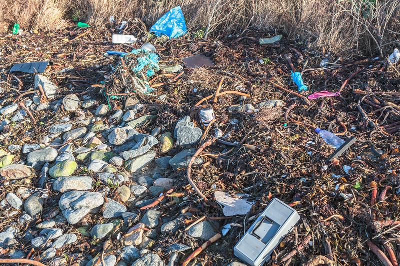 Strand line litter at the top of the shore of Champ Rouget, Chouet on Guernsey's north coast on 4th February 2014