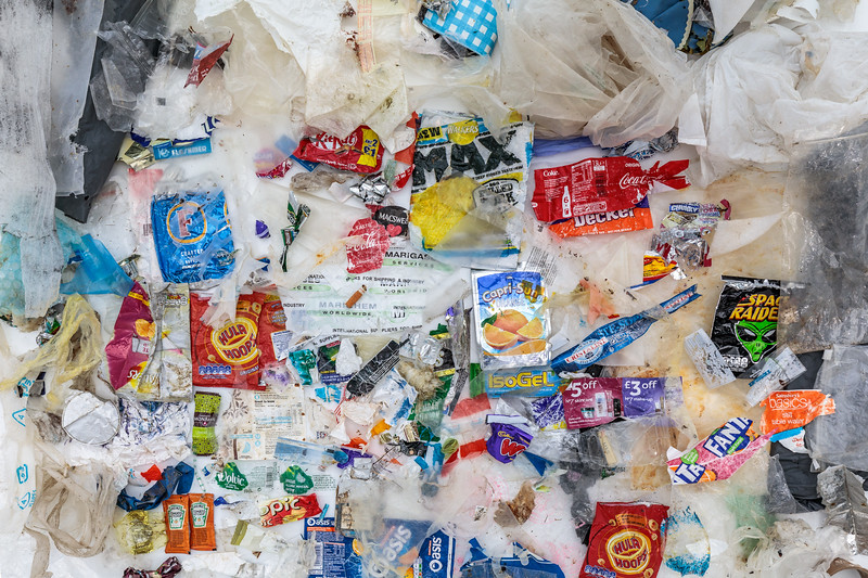 Plastic film, bags, and food packaging wrappers collected from the Guernsey sea shore
