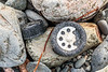 Plastic bottle top and screw lid on the Pleinmont sea shore on Guernsey's southwest coast on 9th October 2020