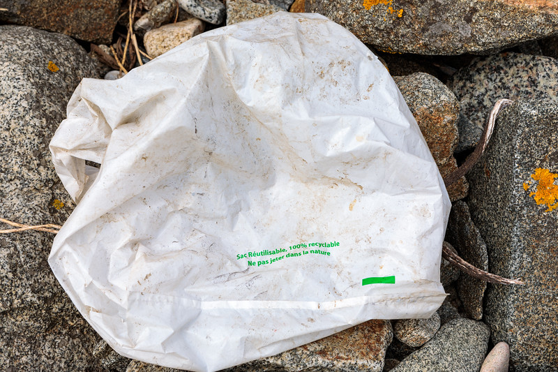 100 percent recyclable plastic bag on the sea shore at Champ Rouget, Chouet on Guernsey's north coast on 26 May 2018