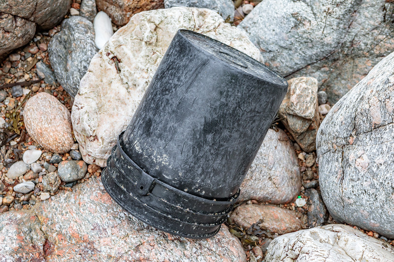 Plastic bucket with barnacles attached inside washed up at Petit Port on Guernsey's south coast on 28th February 2020