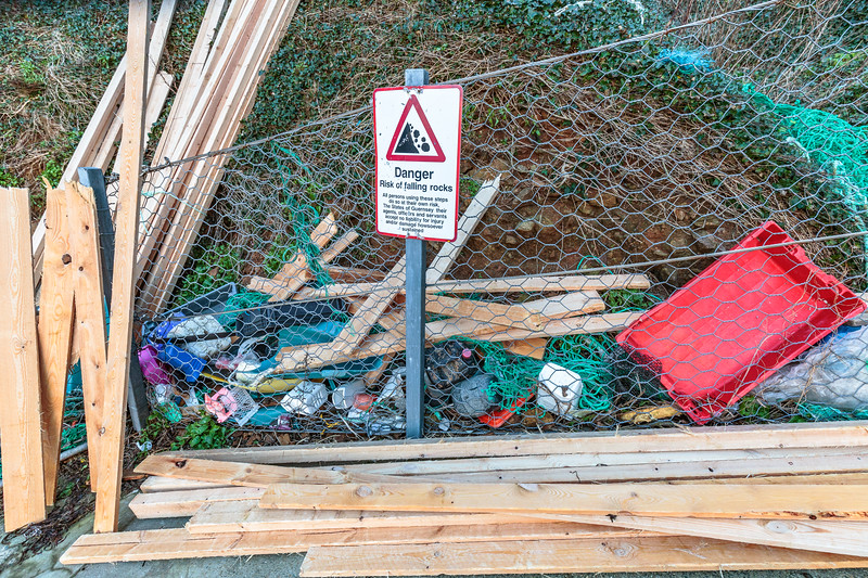 Lumber from the MV Koningsborg cargo spill and plastic debris collected from Petit Port on Guernsey's south coast
