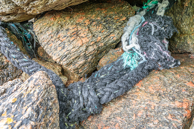 Nylon hawser trapped by large boulders at Petit Port on Guernsey's south coast