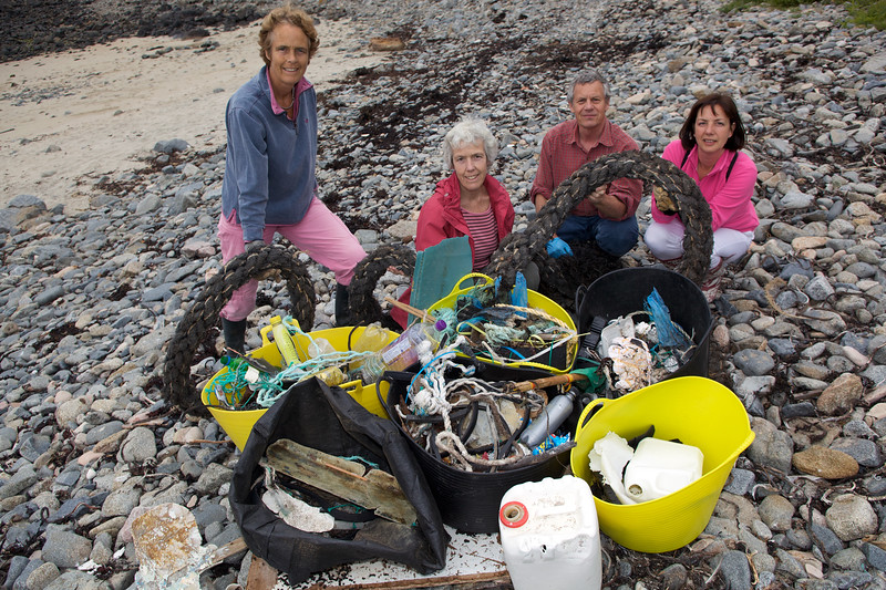 Sea shore litter collectors with haul of beach litter at Champ Rouget on Guernsey's north-west coast on 6th June 2009