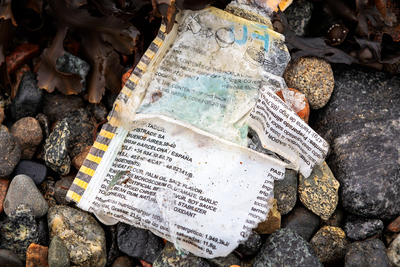 Food packaging litter of Spanish origin on the Belle Greve Bay sea shore on 13th January 2018