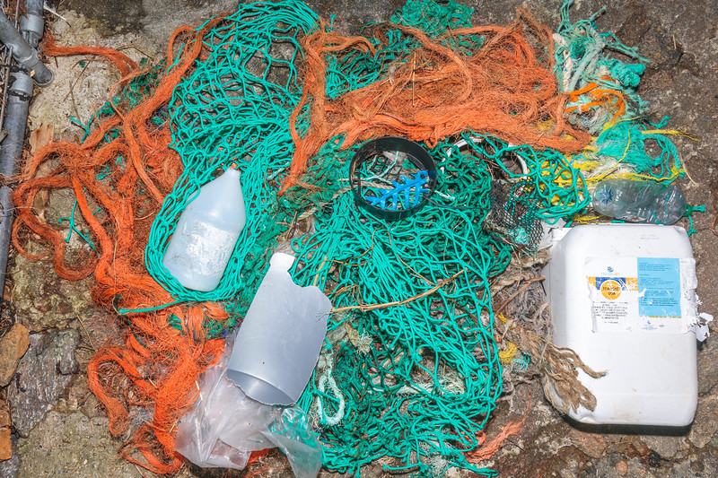 Some of the Petit Port sea shore litter that had been placed behind the fence so it wouldn't be taken out to sea again