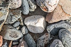 Piece of polystyrene resembling the cobbles and pebbles surrounding it on the Pleinmont shore on 9th October 2020