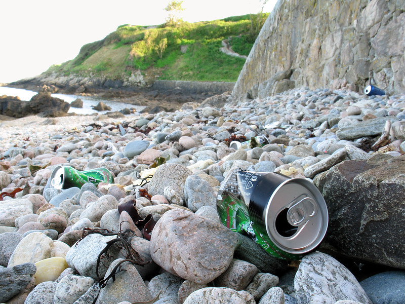 Drink cans left on the sea shore at La Valette, Guernsey