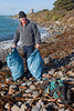 Regular Guernsey volunteer beach cleaner Paul Le Gallez at Champ Rouget
