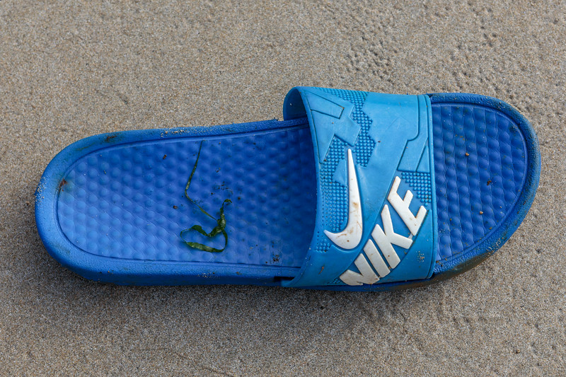 Single Nike flip flop found in a crevice in a cave in the fifth ravine to the west of Petit Port on 20th September 2020