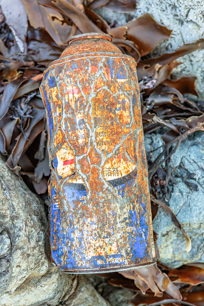 Rusty can with Asian text found in a small cove at Pleinmont on Guernsey's south west coast on 9th October 2020