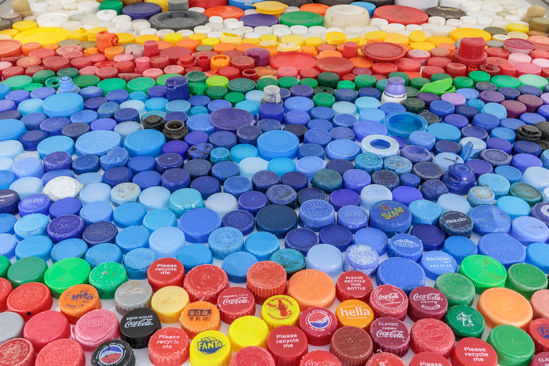 Plastic bottle tops collected from the Guernsey sea shore