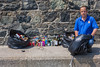 St Peter Port douzenier Neil Forman with bags of litter collected from Belle Greve Bay on 21 July 2013