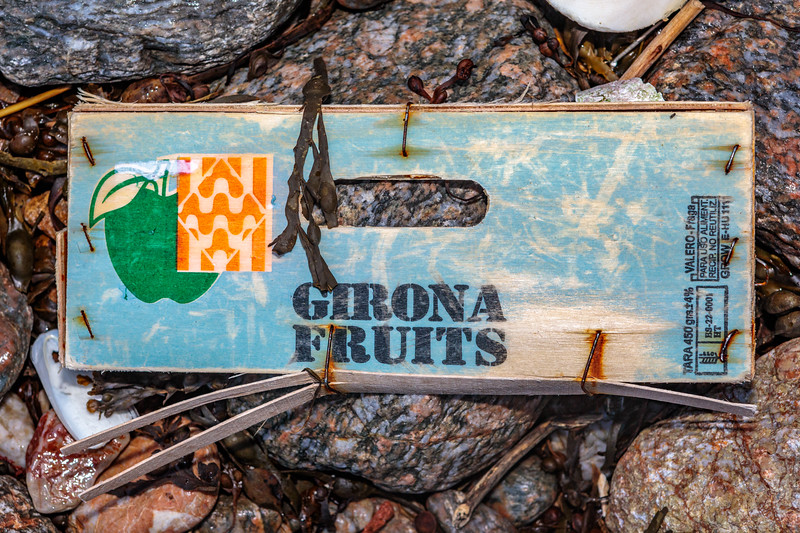 Side of Girona Fruits box from Spain at Petit Port  on Guernsey's south coast
