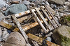 Broken up wood pallet on the Petit Port sea shore on Guernsey's south coast on the 24th May 2021