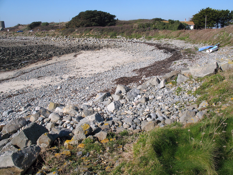 The Champ Rouget shore near Chouet that Guernsey Climate Action Network (G-CAN) members have decided to clean of marine litter on a regular basis.  The shore accumulates marine debris discarded by shipping and fishing boats in the English Channel.  This image shows the shore during a neap tide after the clean-up.  We left two broken-up crab and lobster pots above the high water mark near the dinghies as they were too cumbersome to remove. <br /> File No. 170208 3192<br /> ©RLLord<br /> fishinfo@guernsey.net