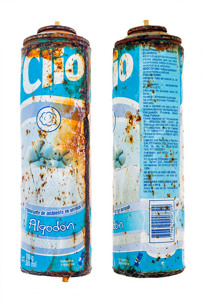 Rusty can of Clio from Argentina on the sea shore at Pleinmont on Guernsey's south-west coast