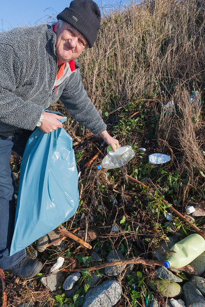 Beach clean volunteer Paul Le Gallez collects litter from Champ Rouget, Guernsey on 4 February 2014