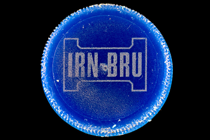 Irn Bru blue plastic bottle top collected as beach litter from the Guernsey sea shore