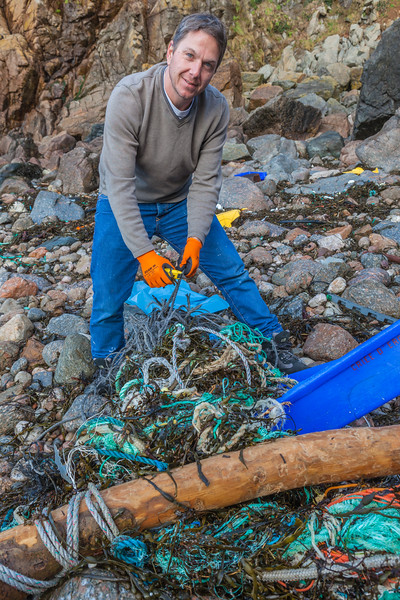 Mark Litten works on removing a bundle of tangled Nylon rope from the sea shore at Petit Port, Guernsey