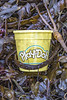 Play-Doh plastic container in the seaweed strand line at Petit Port on Guernsey's south coast on 18th December 2020