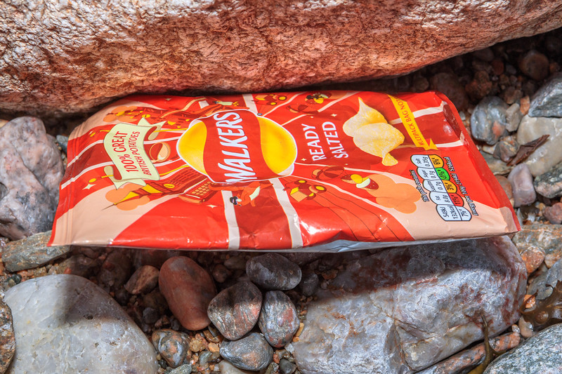 Walkers crisp packaging on the shore at Petit Port on Guernsey's south coast on 4th March 2020
