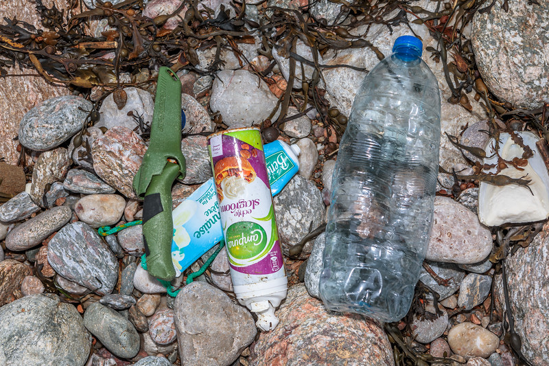 Litter on the Petit Port sea shore on 10 February 2019
