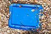 One of two blue plastic box lids on the shore of Fermain Bay on Guernsey's east coast on 18th September 2020