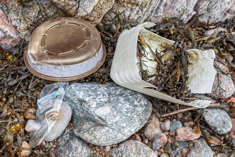 Plastic litter on the Petit Port sea shore on 4 March 2019