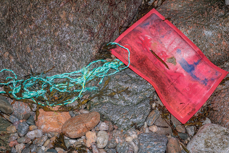 Rope and plastic mat with Chinese writing washed up at Petit Port on Guernsey's south Coast
