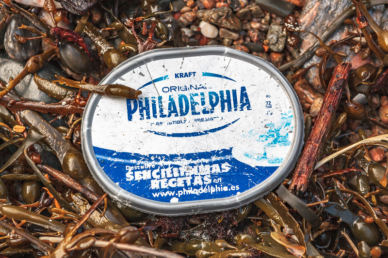 Plastic lid of Philadelphia cream cheese container from Spain washed up at Petit Port on 16th February 2014