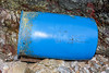 Fisherman's blue drum washed-up on the Petit Port sea shore and placed behind the fence at the top of the shore on 14 January 2018