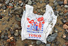 Tesco supermarket plastic bag on the Belle Greve Bay shore on Guernsey's east coast on 13 January 2018