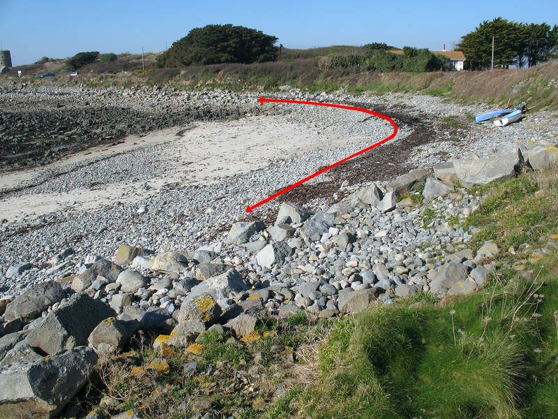 Stretch of sea shore at Champ Rouget, Chouet that has been cleared of marine litter repeatedly over the years