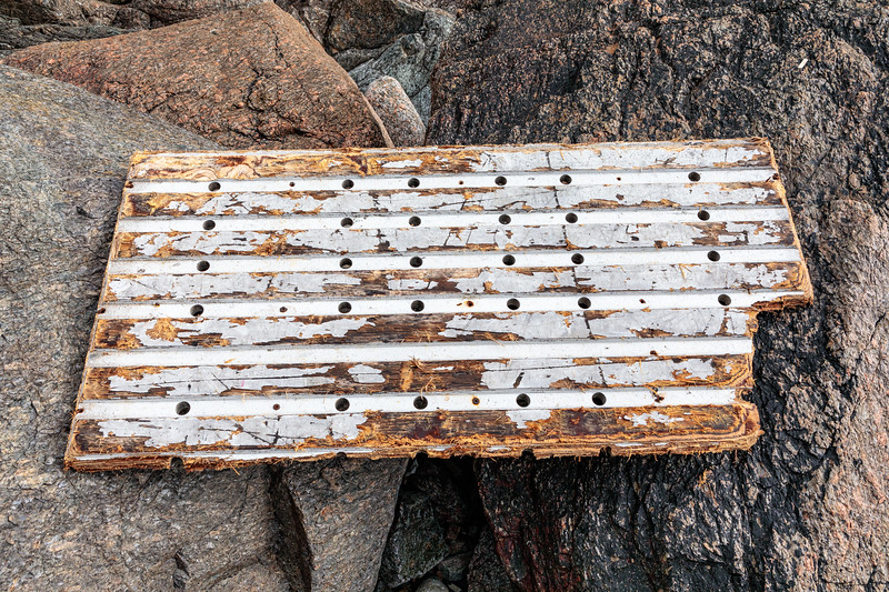 Wood floor of ship's refrigerated room was trapped in the western boulder field at Petit Port on 26th February 2020