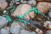 Thick, twisted rope and black plastic piece at Petit Port on Guernsey's south coast on 17th February 2020
