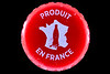 Red plastic bottle top with the words 'Produit en France' collected from Petit Port on Guernsey's south coast