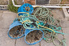 A string of three whelk pot plastic tops washed up and brought to the Portelet kiosk on Guernsey's west coast