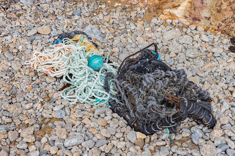 Damaged parlour pot, ABS plastic float, and long rope washed up at Soldiers Bay on Guernsey's east coast