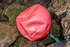 A partially deflated Polyform buoy trapped in boulders at Petit Port on Guernsey's south coast on 28th February 2020