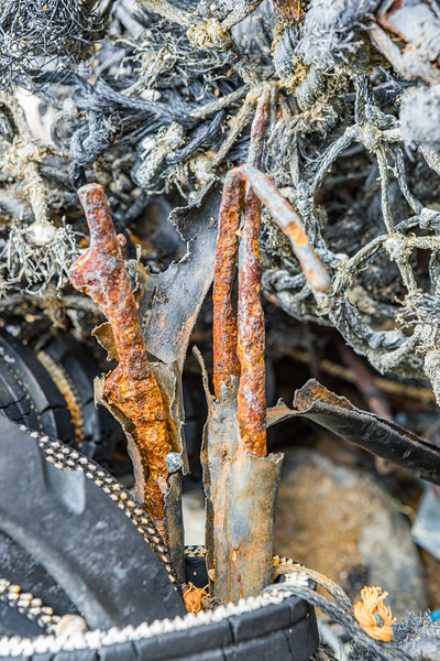 Close up of the rusted metal frame of a parlour pot washed up at Soldiers Bay on Guernsey's east coast