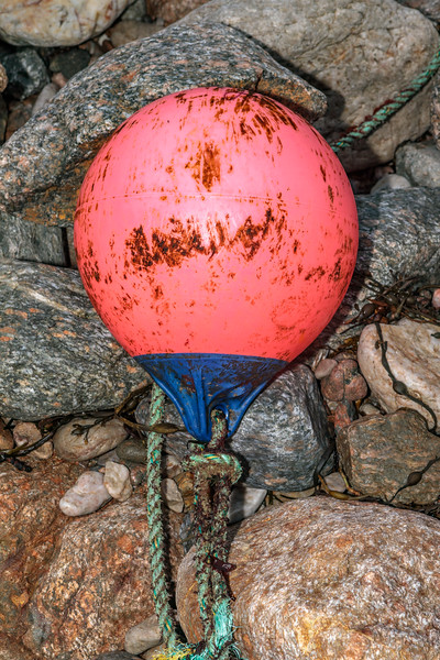 Polyform buoy from Guernsey fishing boat Genesis GU 240 on the shore at Petit Port on Guernsey's south coast
