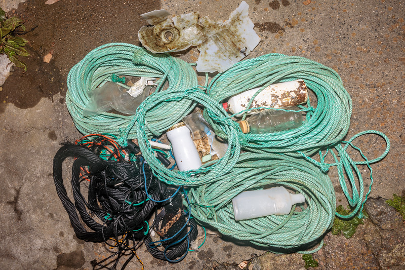 Nylon rope and plastic bottles washed up at Petit Port on Guernsey's south coast